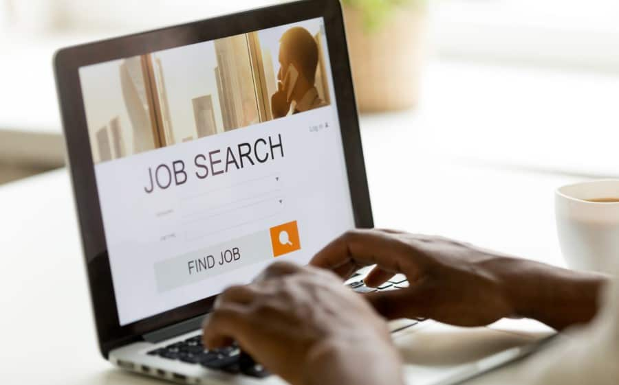 stock-photo-african-man-browsing-work-opportunities-online-using-job-search-computer-app-black-jobless-seeker-1044298738