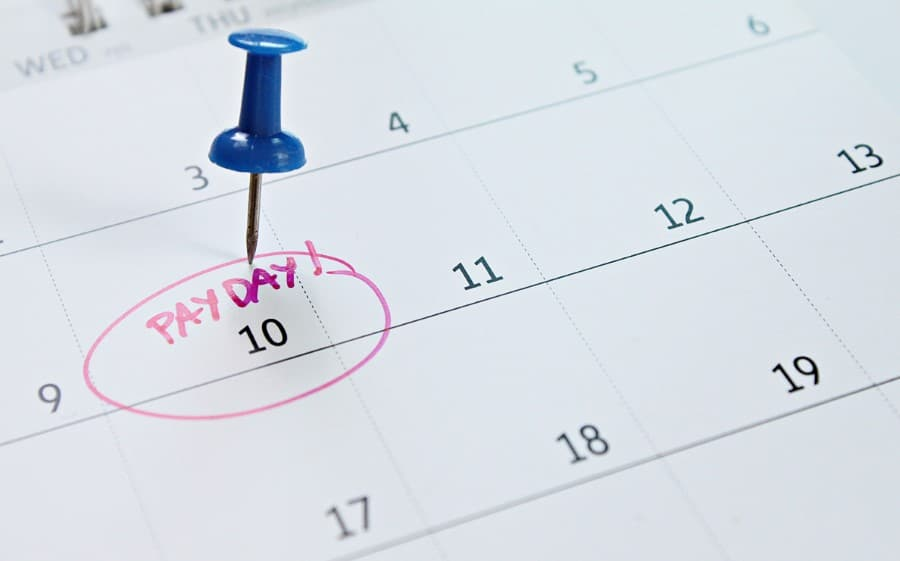 stock-photo-business-finance-savings-money-wages-payroll-or-accounting-concept-calendar-with-blue-1172049514