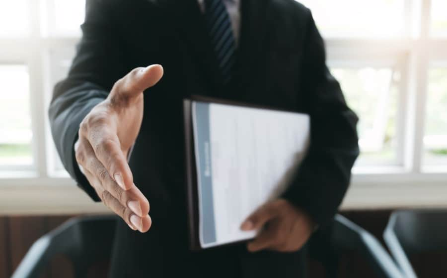 stock-photo-business-find-new-job-interview-the-job-and-hiring-job-applicant-holding-resume-open-handshake-690895558