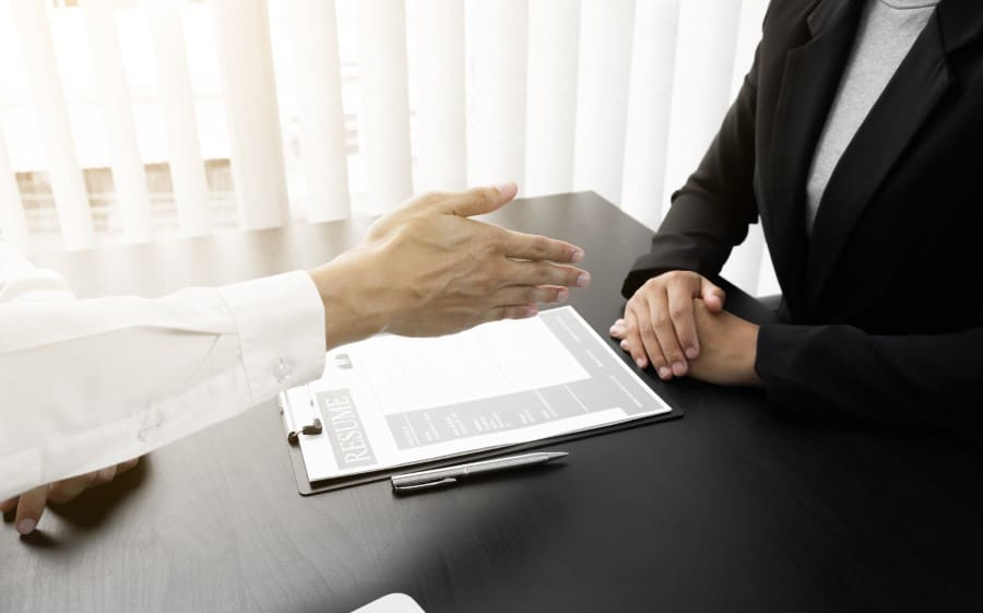 stock-photo-closeup-hand-of-interview-employee-is-reach-out-one-s-hand-for-make-handshake-with-jobseeker-in-the-1748485166