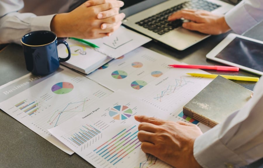 stock-photo-two-businessman-investment-consultant-analyzing-company-financial-report-balance-sheet-statement-666400981
