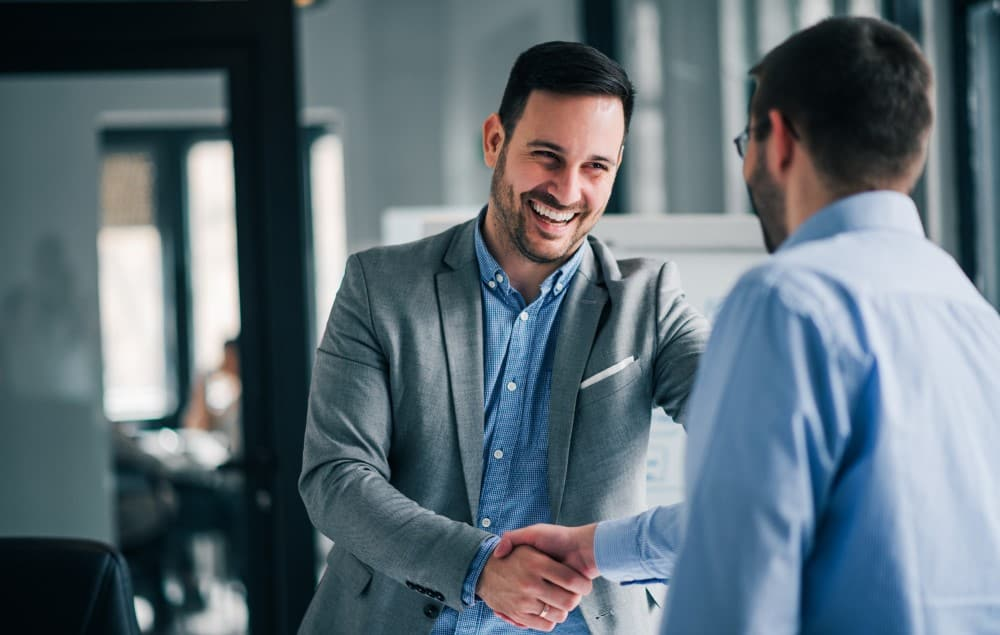 stock-photo-portrait-of-cheerful-young-manager-handshake-with-new-employee-1312231271